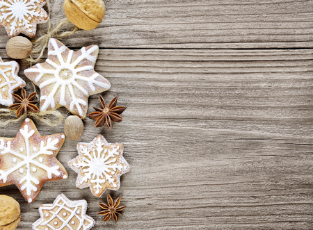 Gingerbread cookies and spices on the wooden background photo