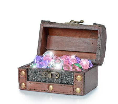 wooden chest with jewels on a white background