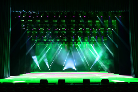 Illuminated empty concert stage with smoke