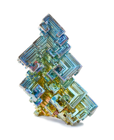tarnish: Skeletal crystals of bismuth with tarnish on a white  Stock Photo