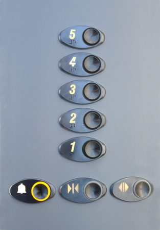 arabic numerals: Metal panel in the elevator with Arabic numerals and inscriptions in Braille