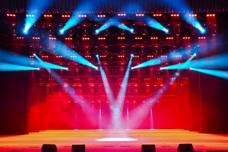 Illuminated empty theater stage with smoke Archivio Fotografico