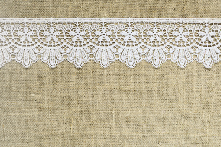 lace frame: Lace border over burlap Stock Photo