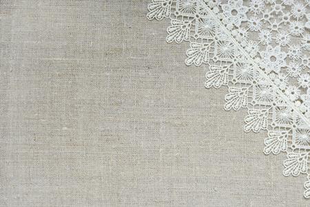 Lace border over burlap Standard-Bild
