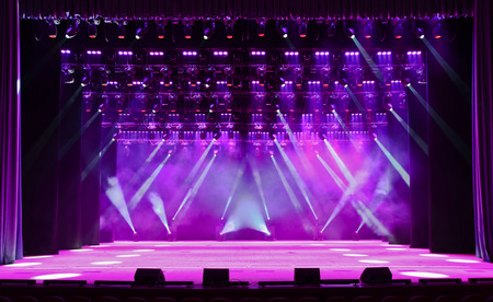 Illuminated empty concert stage with smoke and rays of light Archivio Fotografico