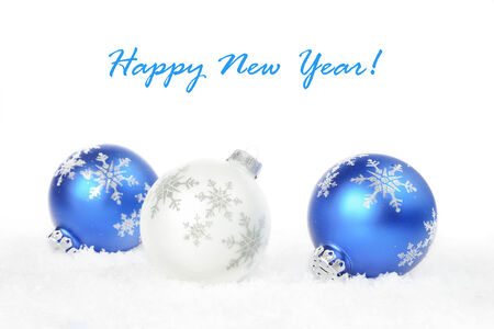 White and blue Christmas balls with a snowflakes on a white background photo