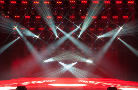 Illuminated empty theater stage with smoke. Star-shaped filter