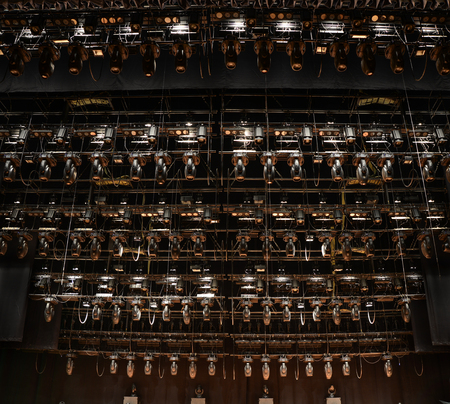 Big set of stage lighting equipment on an empty theater stage photo