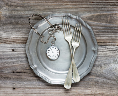 Two vintage fork on a pewter plate