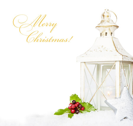 Christmas composition with space for text, burning lantern, snow and holly berries on a white background photo