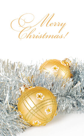 blanch: Greeting card with space for text with a pair of golden christmas balls on silver tinsel