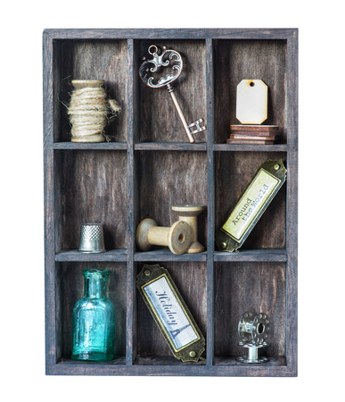sewing label: Wooden shadow box with with various sewing accessories and vintage knickknacks Stock Photo