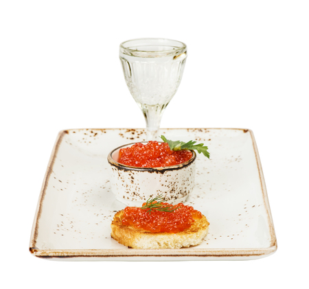 sandwiche: Sandwiche with red caviar and glass of vodka on a porcelain plate Stock Photo