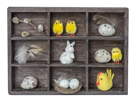 fuzz: Old wooden shadow box with different elements of Easter decorations Stock Photo