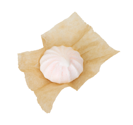 kiss biscuits: One meringue in the packaging paper isolated on white background