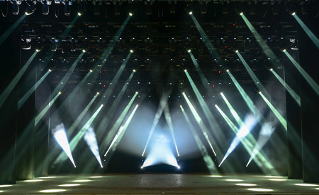 theatre performance: Illuminated empty concert stage with smoke and rays of light Stock Photo