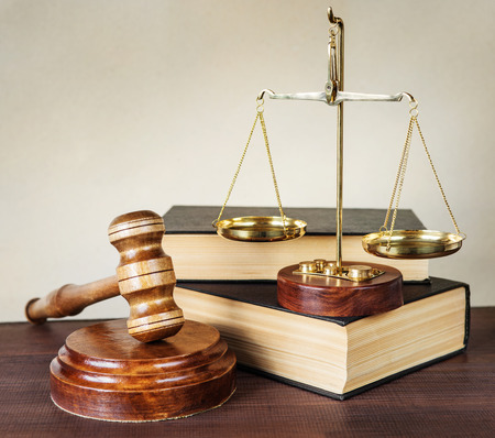 civil law: Symbols of law: wood gavel, soundblock, scales and two thick old books Stock Photo