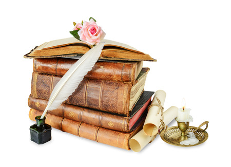 inkpot: Old books, burning candle in candlestick, white feather in inkpot, rose flower and scroll with stamp, isolated on white background