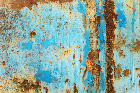 Multicolored background: rusty metal surface with blue paint flaking and cracking texture Stockfoto