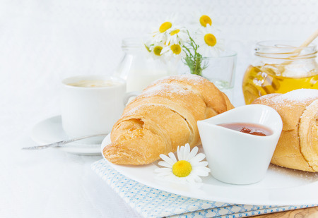 continental breakfast: Continental breakfast with croissant, cup of coffee, jam and honey Stock Photo