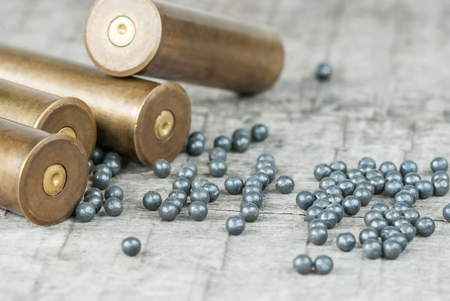 plumbum: Hunting cartridges and lead shot  on the old wooden boards