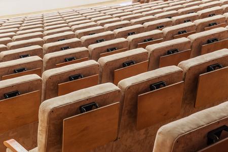 dramatics: Rows of beige velvet armchairs in the auditorium