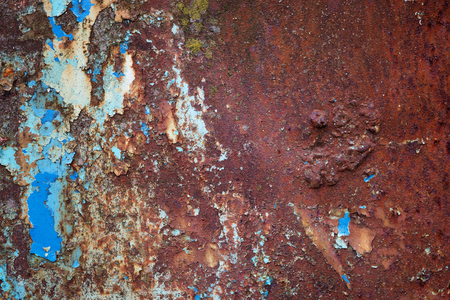crackles: Old rusty metal surface with blue paint flaking and cracking texture