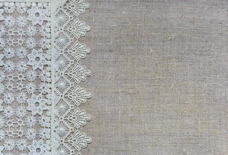 White lace vertical border over rough burlap