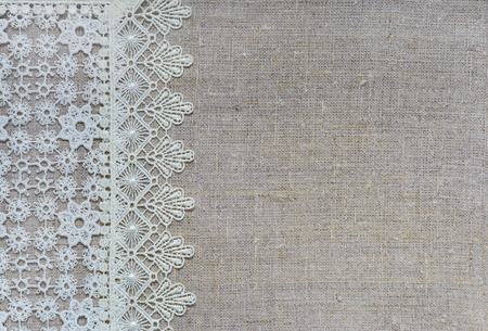 White lace vertical border over rough burlap