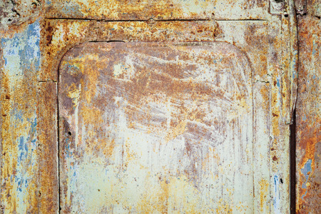 crackles: Old rusty metal door with blue paint flaking and cracking texture
