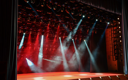 light beams: Illuminated empty concert stage with smoke and light beams Stock Photo