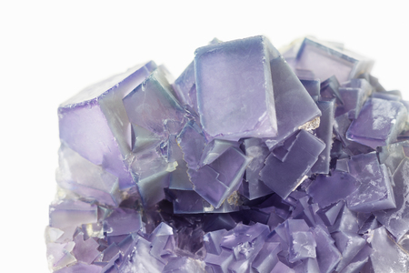 twinning: Purple fluorite crystal cluster close-up  isolated on a white background Stock Photo