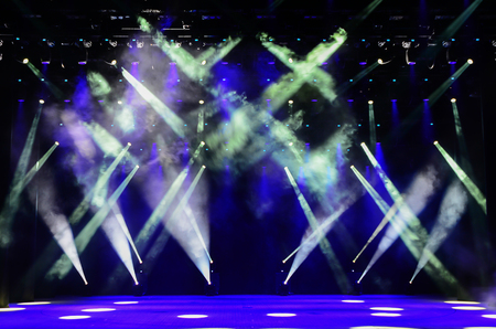 dramatics: Illuminated empty concert stage with blue light and stage fog