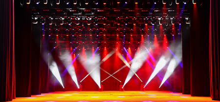 dramatics: Illuminated empty concert stage with red light and stage fog Stock Photo