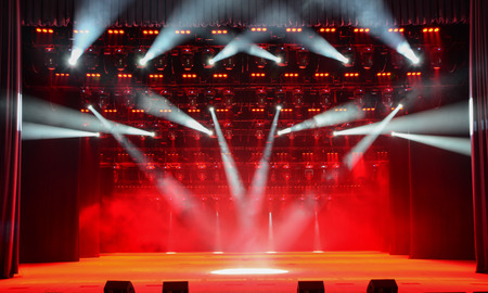 dramatics: Illuminated concert stage without people, with red light and stage fog