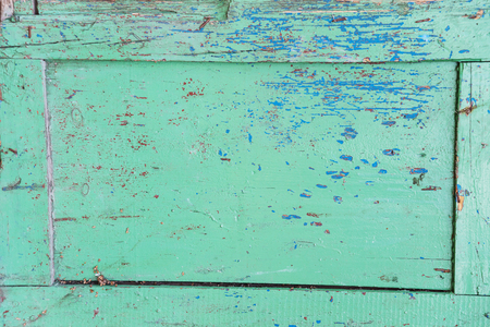 crackles: Old wooden board in the frame, painted with green paint