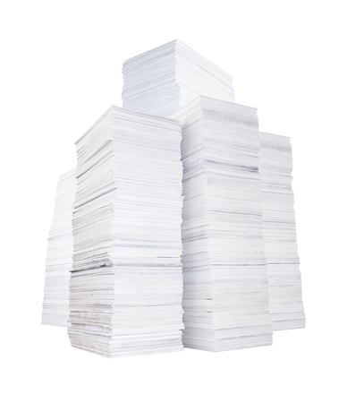 Several high stacks of paper isolated on white background