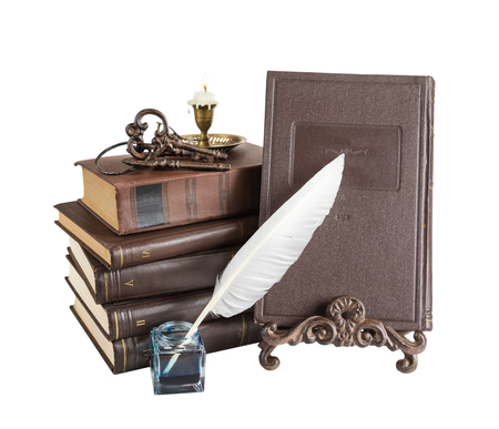 inkpot: Old books, burning candle in candlestick, feather pen in inkpot,  bookrest and bunch of keys, isolated on white background