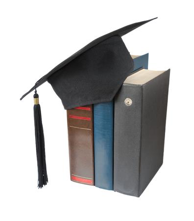 black graduate: Black graduate hat and big books, isolated on white background