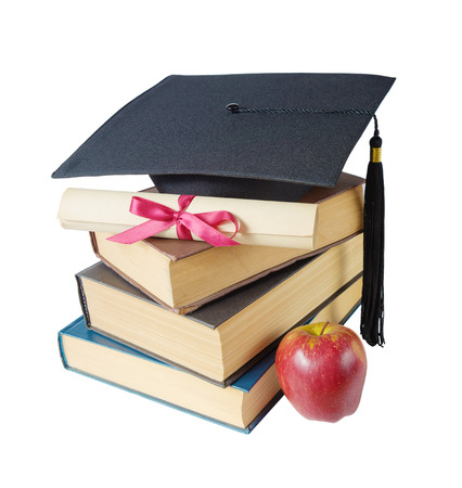 yellow tassel: Black graduate hat, stack of big books, red apple and paper scroll tied with red ribbon with a bow, isolated on white background