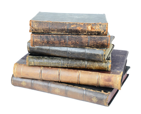 Stack of old hardcover books isolated on white background
