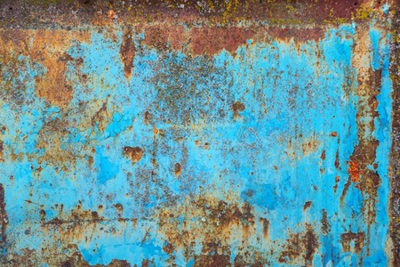 Multicolored background: rusty metal surface with blue paint flaking and cracking texture Imagens