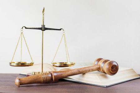 Symbols of law: wood gavel, soundblock, scales and opened volumetric old books Stock Photo