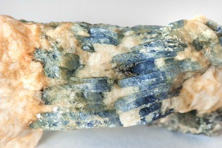 lamellar: Specimen collectible of blue lamellar Sapphire in matrix close-up, Ural