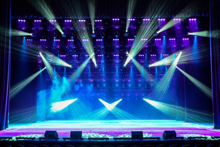 Illuminated empty show stage with blue light and stage fog Stock Photo