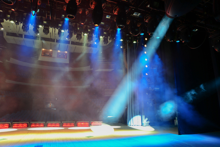 View from the illuminated empty show stage to the dark auditorium