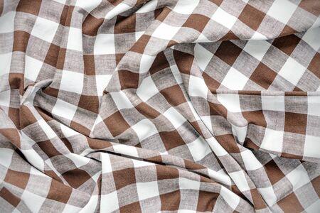 creasy: Creasy white and brown checked cotton fabric closeup Stock Photo