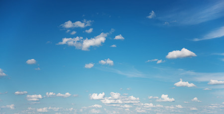Panorama of vast blue summer sky with fluffy white cumulus clouds Stock Photo