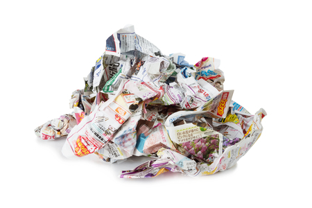Large pile of colored crumpled Japanese newspapers isolated on a white background Stock Photo