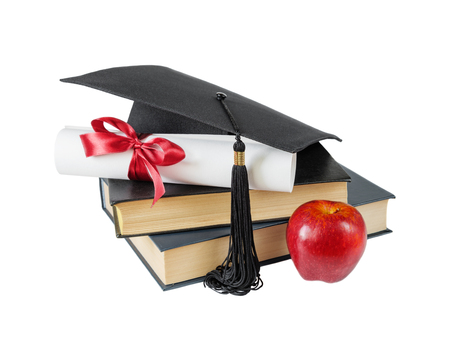 Concept of education: black graduate hat, stack of big books, red apple and paper scroll tied with red ribbon with a bow, isolated on white background
